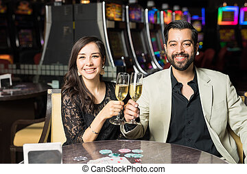 Couple drinking champagne in a casino