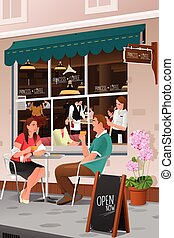 Couple drinking coffee at an outdoor cafe