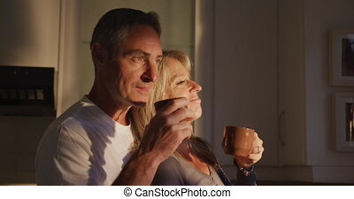 Couple drinking coffee at home