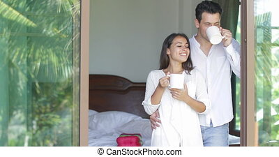 Couple Drinking Coffee Embracing Enjoy View From Window,...