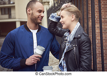 Couple drinking coffee on the streets