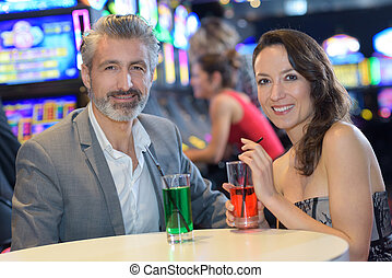 couple drinking in a casino