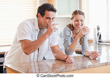 Couple drinking milk in the kitchen