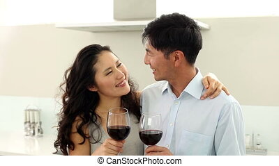 Couple drinking red wine and smilin