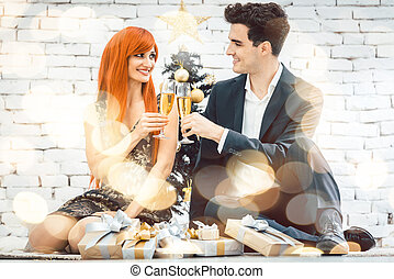 Couple drinking sparkling wine on Christmas