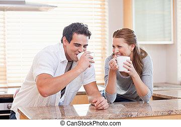 Couple drinking tea in the kitchen
