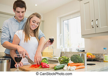 Couple drinking wine and cooking