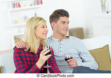 couple drinking wine in home