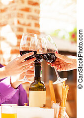 Couple drinking wine in the cafe