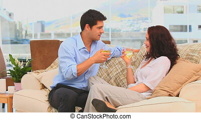 Couple drinking wine in their livin