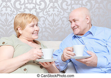 Couple drinks tea at home