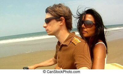 Couple Driving At Beach