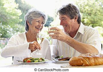Couple Eating An Al Fresco Meal