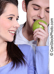 Couple eating an apple