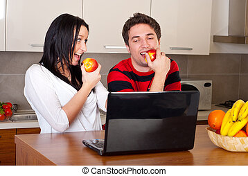 Couple eating apples and having conversation