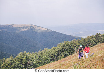 couple eating berries in the mountains together