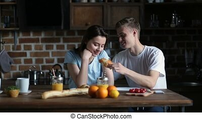 Couple eating breakfast in the morning in kitchen