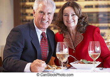 Couple Eating Dinner At A Restaurant