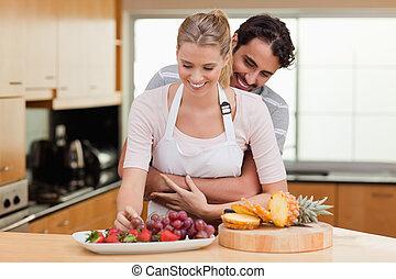 Couple eating fruits