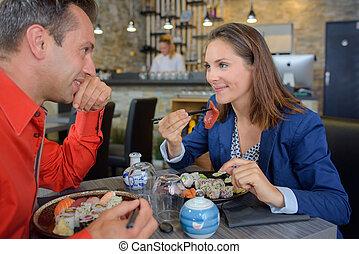 Couple eating sushi