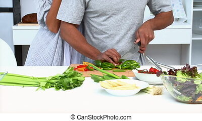 Couple eating vegetables - Cute woman eating while her...