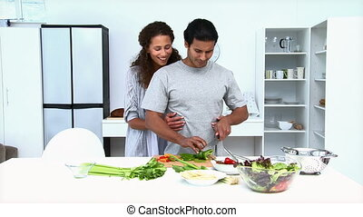 Couple eating vegetables