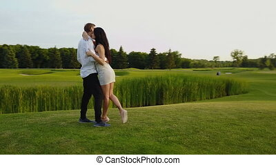 Couple Embracing And Kissing Outdoors, Shooting From Drone...