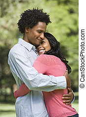 Couple embracing. - Attractive couple smiling and embracing...