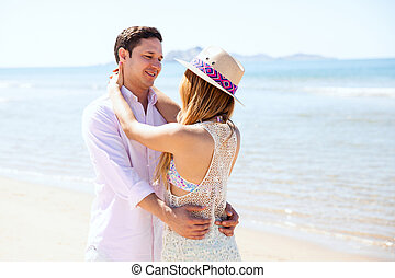 Couple embracing each other at the beach