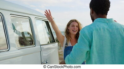 Couple embracing each other near camper van 4k