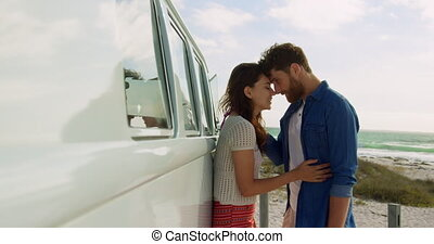 Couple embracing each other near camper van 4k - Side view ...