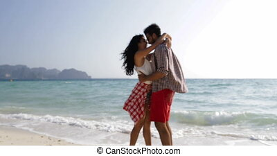 Couple Embracing On Beach, Happy Smiling Man And Woman Hug Toursits On Vacation