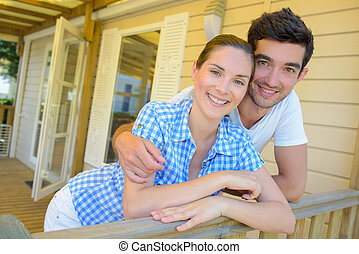 Couple embracing on terrace of chalet
