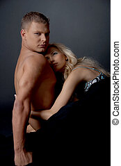 Couple embracing - Young couple embracing