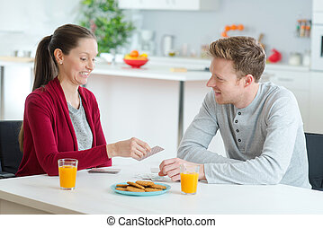 couple enjoying a breakfast together at home