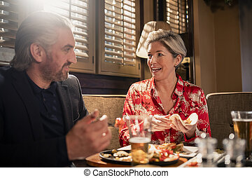 Couple Enjoying a Meal Together