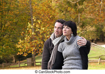 Couple enjoying autumnal walk in the park