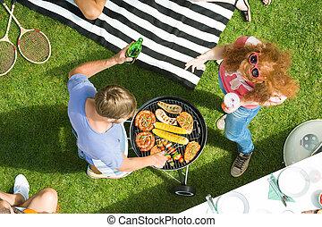 Couple enjoying barbecue garden party