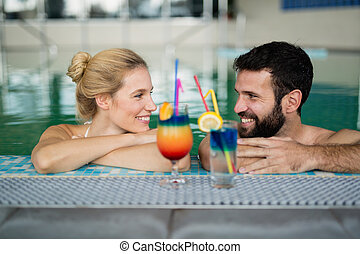 Couple enjoying cocktail in bath