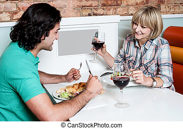 Couple enjoying dinner at a restaurant