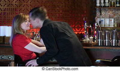 Couple Enjoying Drink In Bar