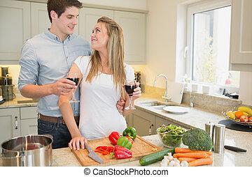 Couple enjoying drinking wine and c