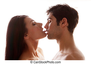 Couple Enjoying Erotic Kiss, both in profile with the woman...