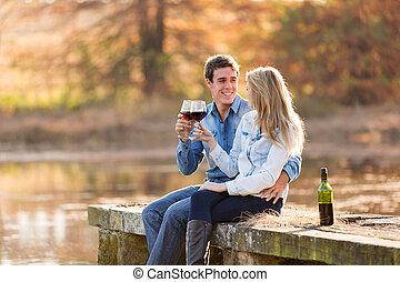 couple enjoying glass of red wine