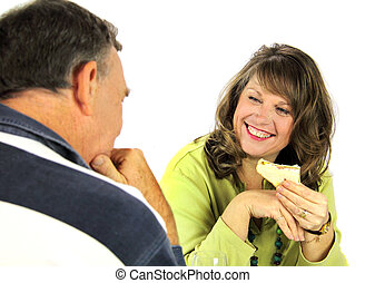 Couple Enjoying Lunch - Middle aged couple laughing and ...