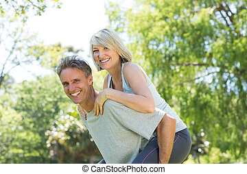Couple enjoying piggyback ride in p