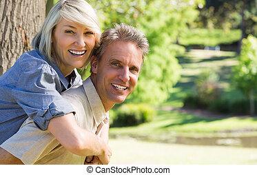 Couple enjoying piggyback ride