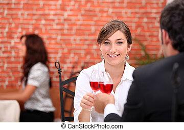 Couple enjoying romantic meal in restaurant