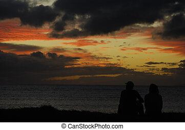 Couple enjoying sunset