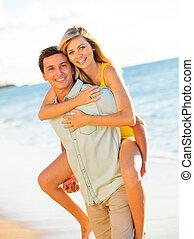 Couple Enjoying Sunset on the Beach